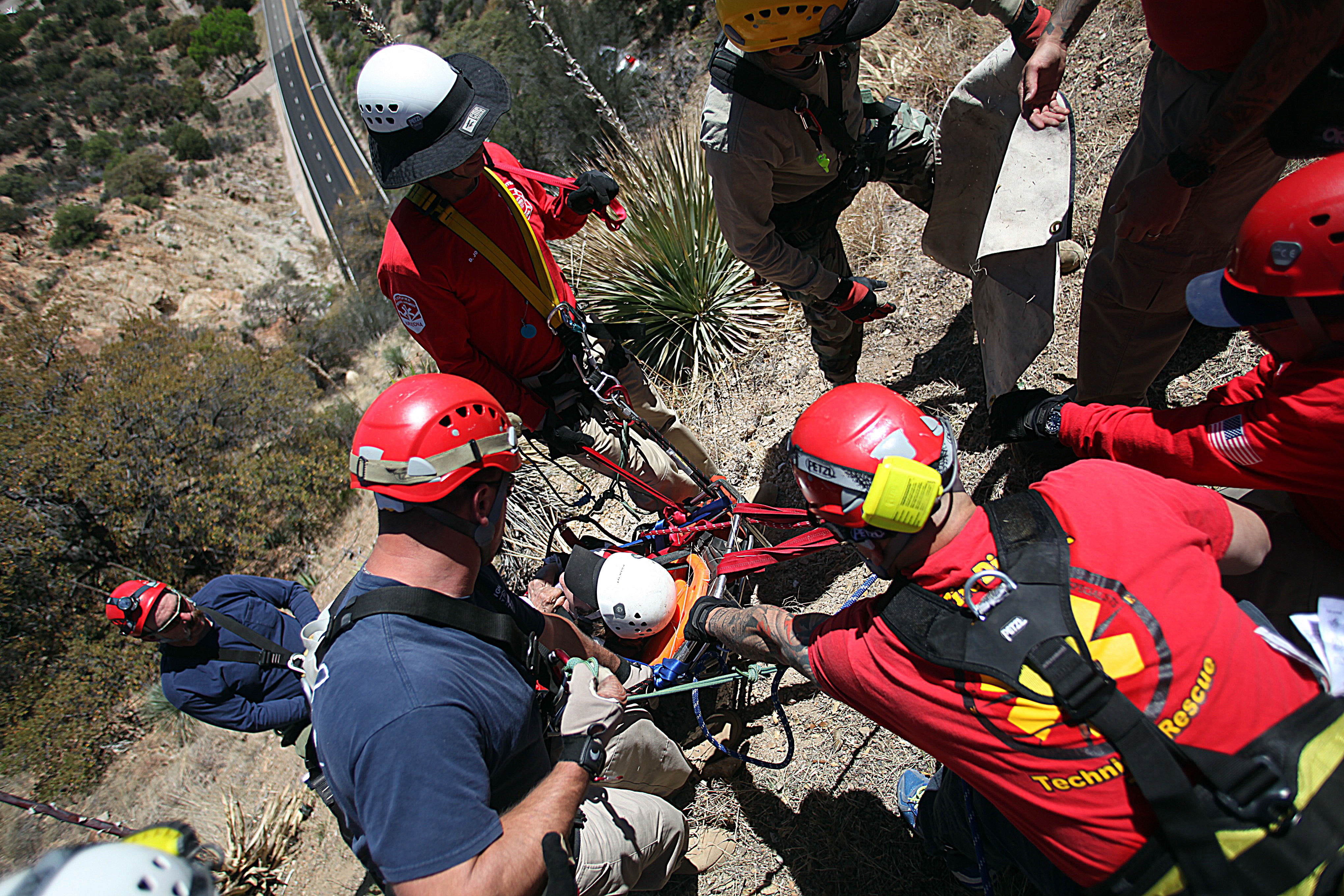 Technical rescue personnel switch gears from training to support the rescue of a woman who had driven off of Mule Pass Rd.